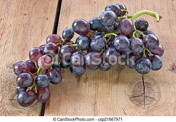 Blue grape on wooden background - csp21667971