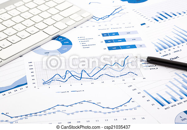 blue graph and chart reports on office table - csp21035437