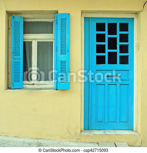 Blue greek shutters window and door in old house - csp42715093