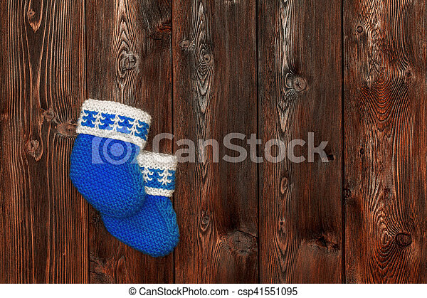 Blue hand made crochet baby booties on wooden background, copyspace - csp41551095