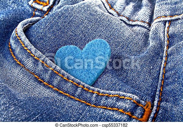 Blue heart in jeans pocket - csp55337182
