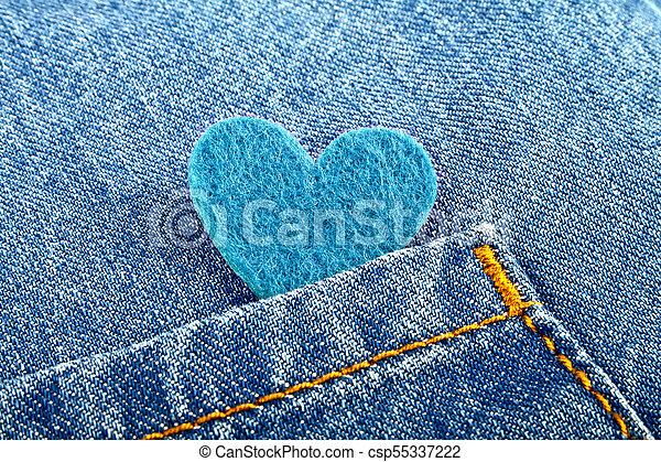 Blue heart in jeans pocket - csp55337222