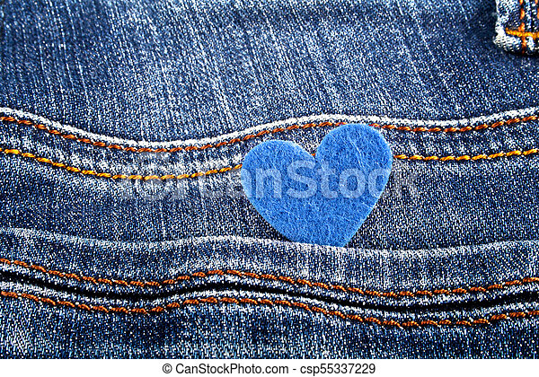 Blue heart in jeans pocket - csp55337229