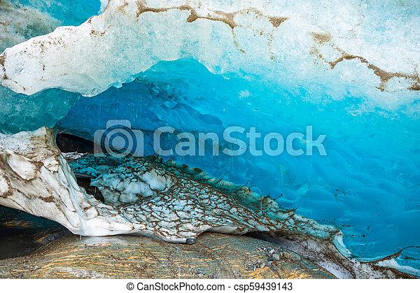 Blue ice cave of Svartisen Glacier, Norway - csp59439143
