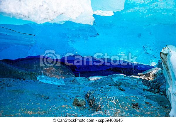 Blue ice cave of Svartisen Glacier, Norway - csp59468645