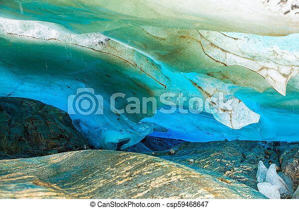 Blue ice cave of Svartisen Glacier, Norway - csp59468647