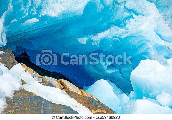 Blue ice cave of Svartisen Glacier, Norway - csp59468920