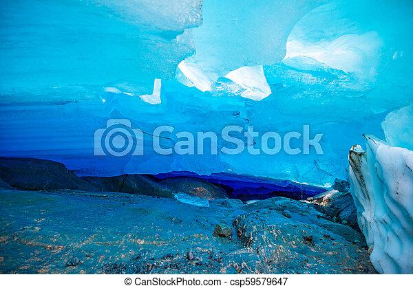 Blue ice cave of Svartisen Glacier, Norway - csp59579647