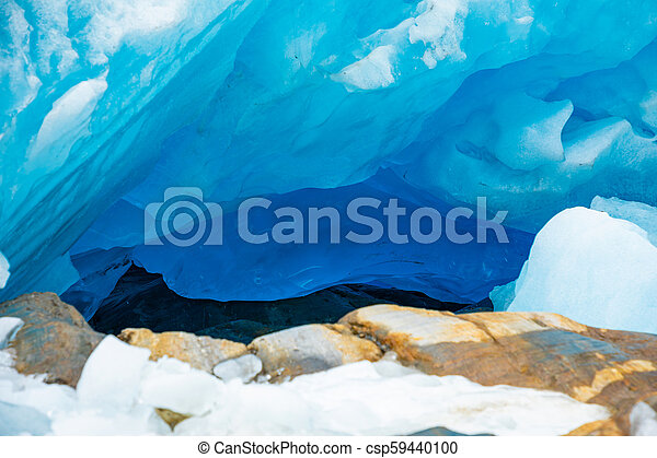 Blue ice cave of Svartisen Glacier, Norway - csp59440100