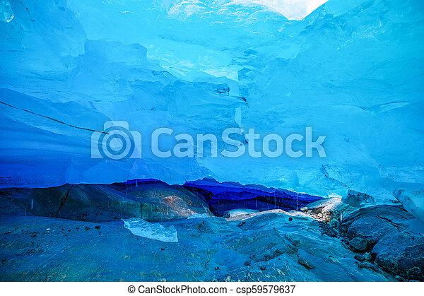Blue ice cave of Svartisen Glacier, Norway - csp59579637