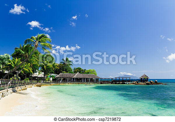 Blue lagoon and a pier in tropical resort, Seychelles - csp7219872