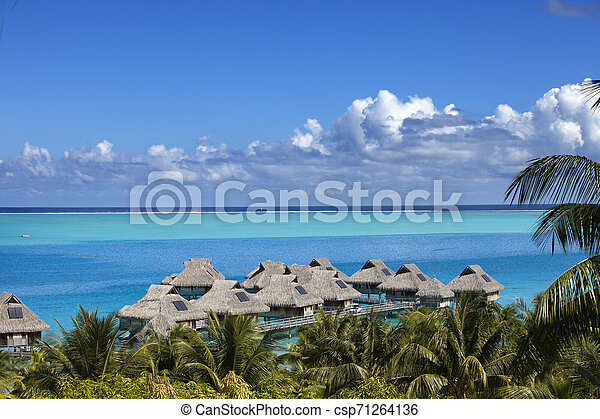 Blue Lagoon Of The Bora Bora Island Polynesia Top View On Palm Trees Traditional Lodges Over Water And The Sea