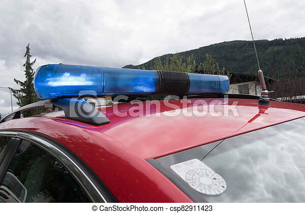 Blue light on roof of fire brigade car - csp82911423