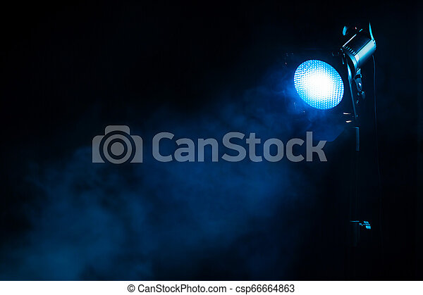 Blue Light With Smoke Equipment For Photo Studio Blue Light With Smoke On Dark Background Equipment For Photo Studio