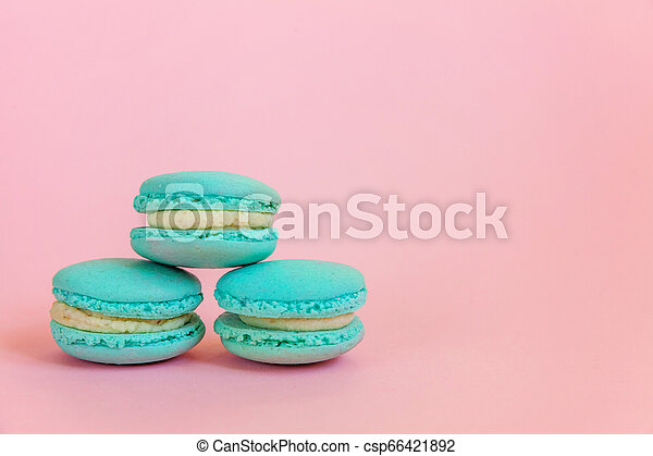 Blue Macaron On Pink Background Sweet Almond Colorful Unicorn Blue Macaron Or Macaroon Dessert Cake Isolated On Trendy Pink