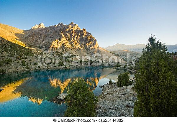 blue mountain lake at sunrise - csp25144382
