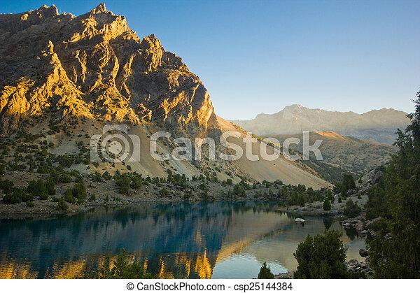 blue mountain lake at sunrise - csp25144384