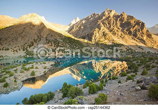 blue mountain lake at sunrise - csp25144362