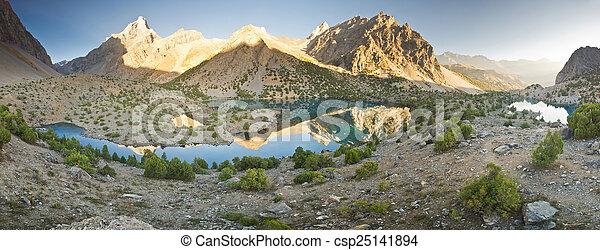 blue mountain lake at sunrise - csp25141894