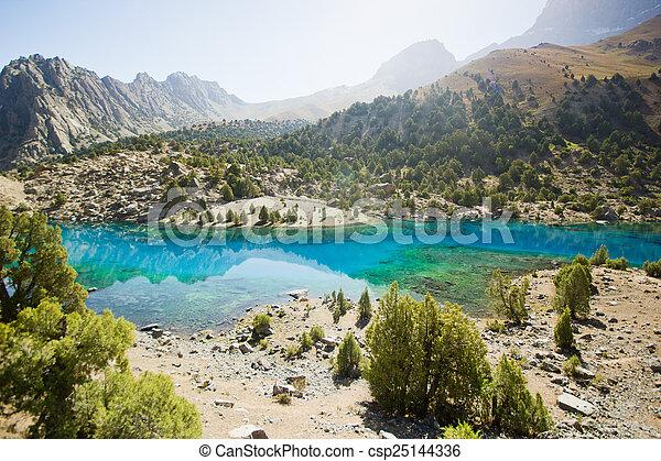 blue mountain lake at sunrise - csp25144336