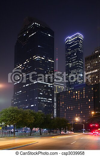 Blue night city lights and buildings in Houston - csp3039958
