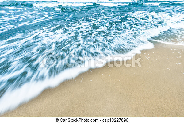 blue ocean waves background with golden sand bright blue ocean
