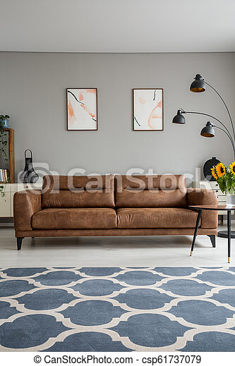 Blue Patterned Carpet And Leather Sofa In Grey Living Room Interior With Posters And Lamp Real Photo Canstock