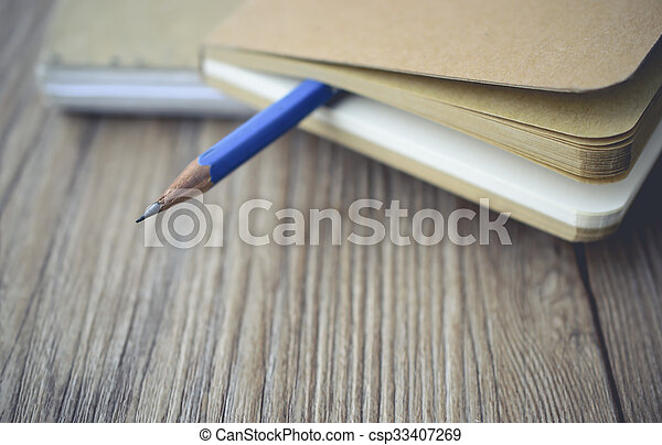 blue pencil log the blank book on wooden with vintage tone