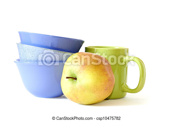 blue plates, green cup and yellow apple - csp10475782
