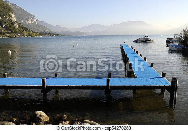 Blue pontoon on Annecy lake, Savoy, France - csp54270283