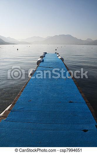 Blue pontoon on lake annecy - csp7994651
