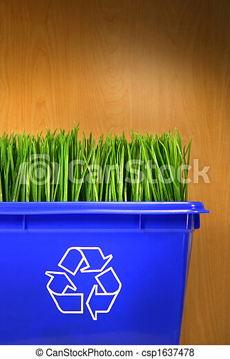 Blue recycle bin with grass inside - csp1637478