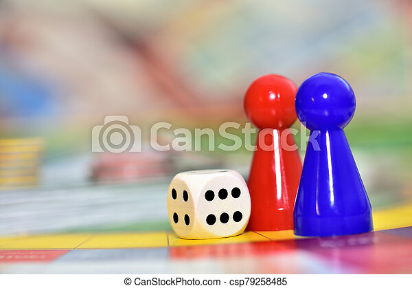 Blue, red play figures and dice on the board game. - csp79258485