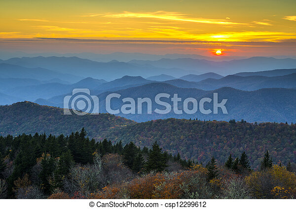 Blue Ridge Parkway Autumn Sunset over Appalachian Mountains Layers covered in fall foliage and blue haze - csp12299612