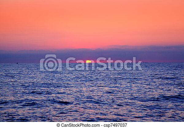 blue sea sunrise with sun in horizon - csp7497037