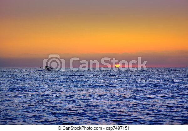 blue sea sunrise with sun in horizon - csp7497151