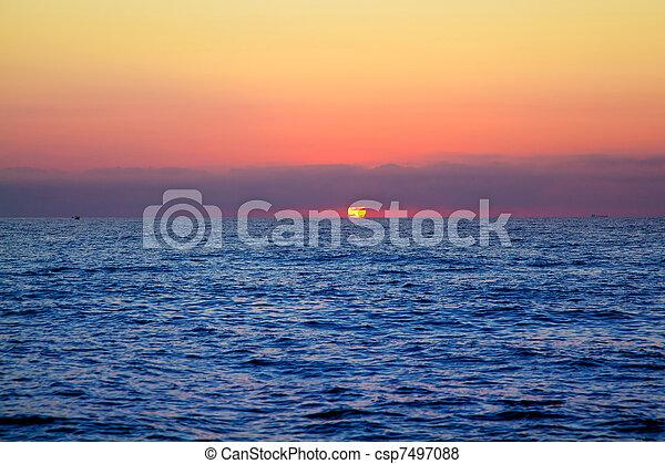 blue sea sunrise with sun in horizon - csp7497088
