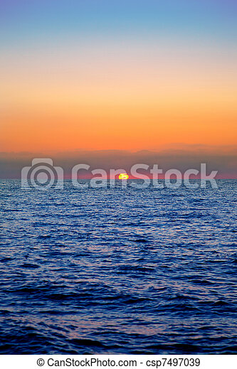 blue sea sunrise with sun in horizon - csp7497039