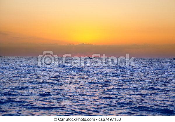 blue sea sunrise with sun in horizon - csp7497150