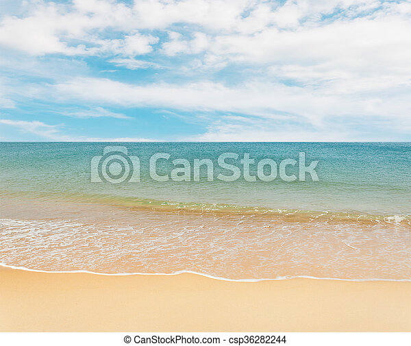 Blue sea with white sand beach on blue sky - csp36282244