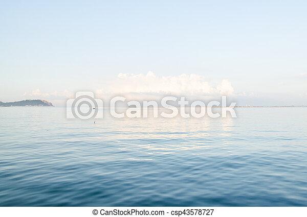 blue sea with white sky - csp43578727