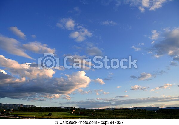 Blue sky background with clouds - csp3947837