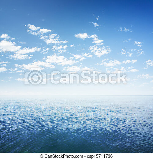 blue sky over sea or ocean water surface - csp15711736