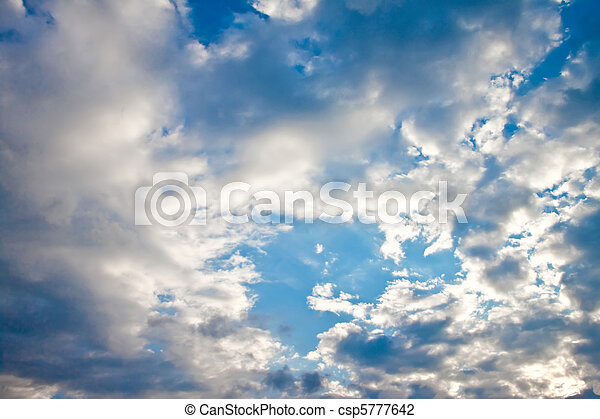 Blue sky with clouds and sun. - csp5777642