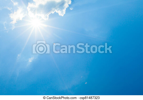 Blue sky with clouds and sun - csp81487323