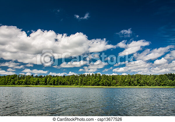 Blue sky with clouds at the lake - csp13677526
