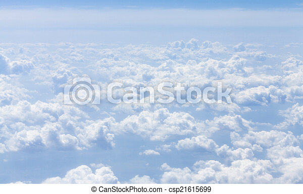 Blue sky with clouds background - csp21615699
