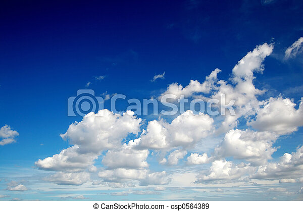 Blue sky with cotton like clouds - csp0564389