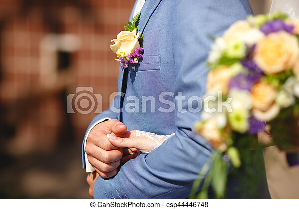 Blue suit and wedding boutonniere - csp44446748