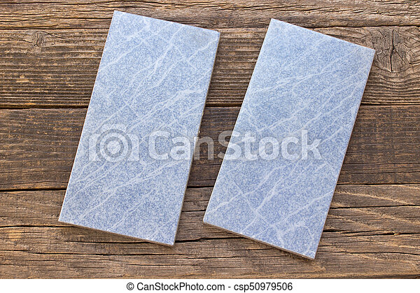 Blue tiles on wooden background - csp50979506